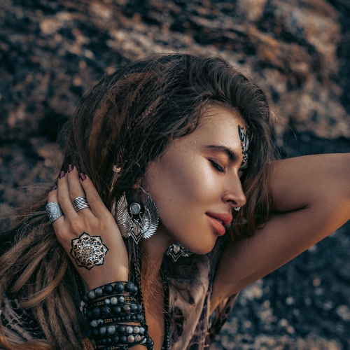 Woman Modeling Jewelry Near Rocks
