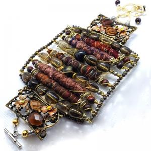 Manifestation of Magic and Miracles (Root Chakra Bracelet with luxurious saree fabric and illuminating gemstones)